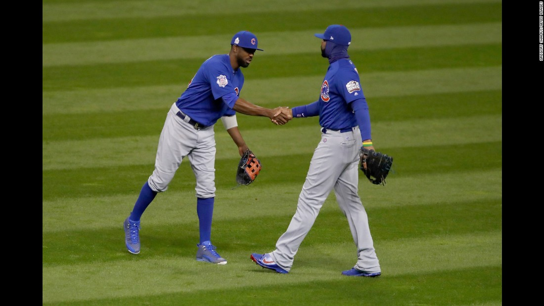 Dexter Fowler of the Cubs celebrates with Jason Heyward after defeating the Indians 5-1 in Game 2.