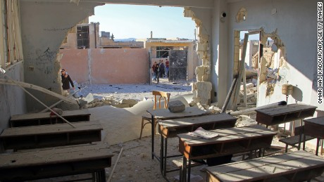 An abandoned classroom after it was hit with airstrikes on Wednesday in the Syrian village of Hass.