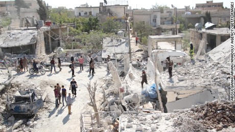 Rescuers from the Syrian Civil Defense and civilians search for victims following the school strikes.