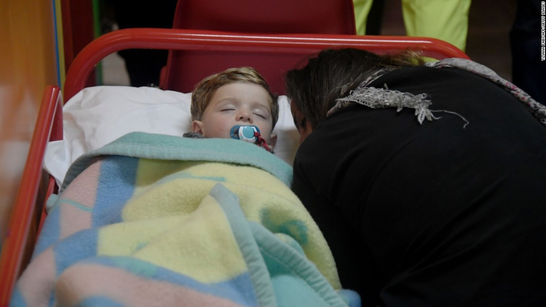 A child sleeps in a secured area after earthquakes rocked Visso on October 26.