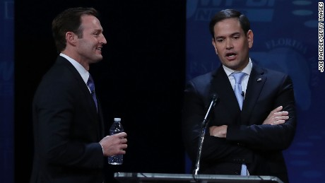 Republican Sen. Marco Rubio (R-FL), (R), and his Democratic challenger Rep. Patrick Murphy (D-FL) speak during a break in  their U.S. Senate debate being held at Broward College on October 26, 2016 in Davie, Florida.