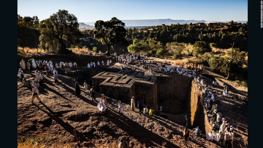 <strong>Words by Tariq Zaidi: </strong>Pilgrims surround the Church of St George in Lalibela, Ethiopia. Shaped like a Greek Orthodox cross, the Church of St George is perhaps the most famous of Lalibela's 11 churches. It was painstakingly excavated out of the rock, some 40 feet down, with hammer and chisel and built after King Lalibela's death by his widow as a memorial.