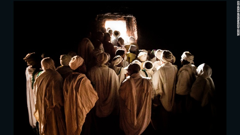 Pilgrims waiting to emerge from inside a tunnel at the House of St George, Lalibela.