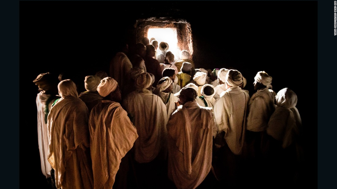 Pilgrims waiting to emerge from inside a tunnel at Bet Girogis or the House of St George, Lalibela. This hand-carved, 12th century church is connected to 12 other churches by a series of tunnels, designed to protect medieval worshipers from attacks, but also to symbolize the movement of pilgrims from darkness to light.