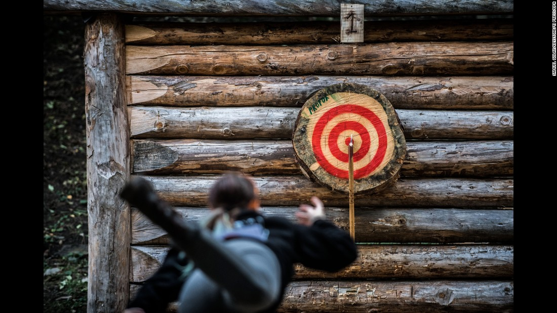 A contestant throws a double axe during an axe-throwing competition in Faido, Switzerland, on Saturday, October 22.