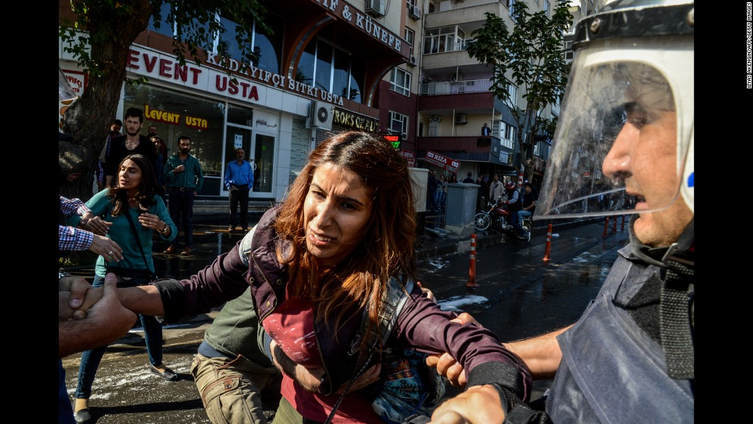 "Police officers hold a protester <a href=""http://www.cnn.com/2016/10/26/middleeast/turkey-detains-kurdish-politicians/"" target=""_blank"">during a demonstration</a> in Diyarbakir, Turkey, on Wednesday, October 26. People were protesting the detention of two prominent Kurdish politicians, including the city's first elected female mayor."