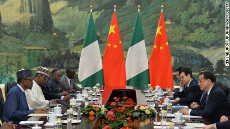 Nigerian President Muhammadu Buhari has dinner with Chinese Premier Li Keqiang in Beijing in April 2016.