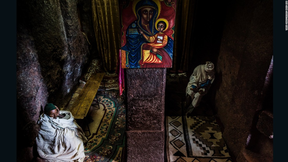 In a prayer room at the House of St George, Lalibela, two priests wait for the day's pilgrims to arrive. Up to 100,000 worshipers travel to these medieval hand-carved churches during times of celebration, to be blessed by the priests and to touch and kiss the sacred walls.