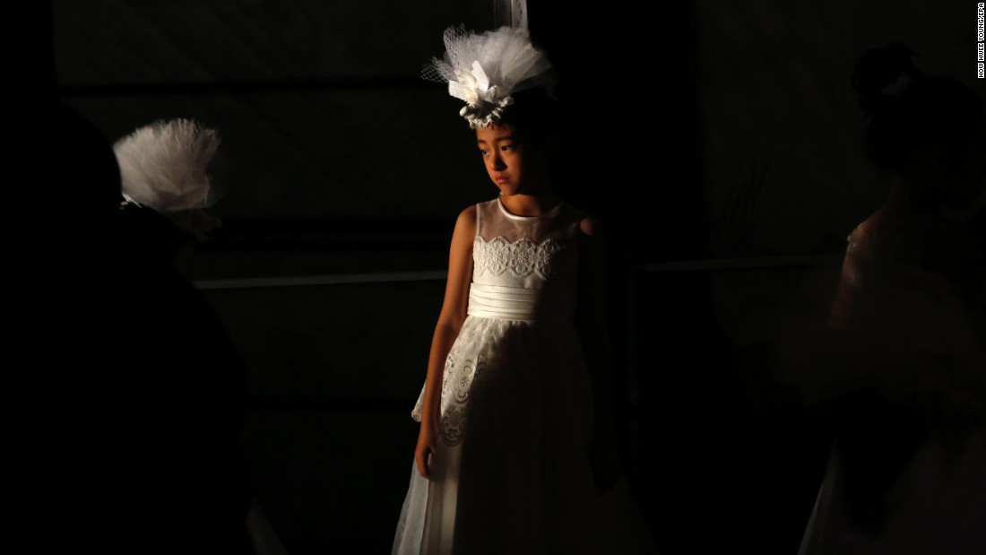 Child models prepare backstage before a J. Queen & Little Queen fashion show in Beijing on Thursday, October 27.