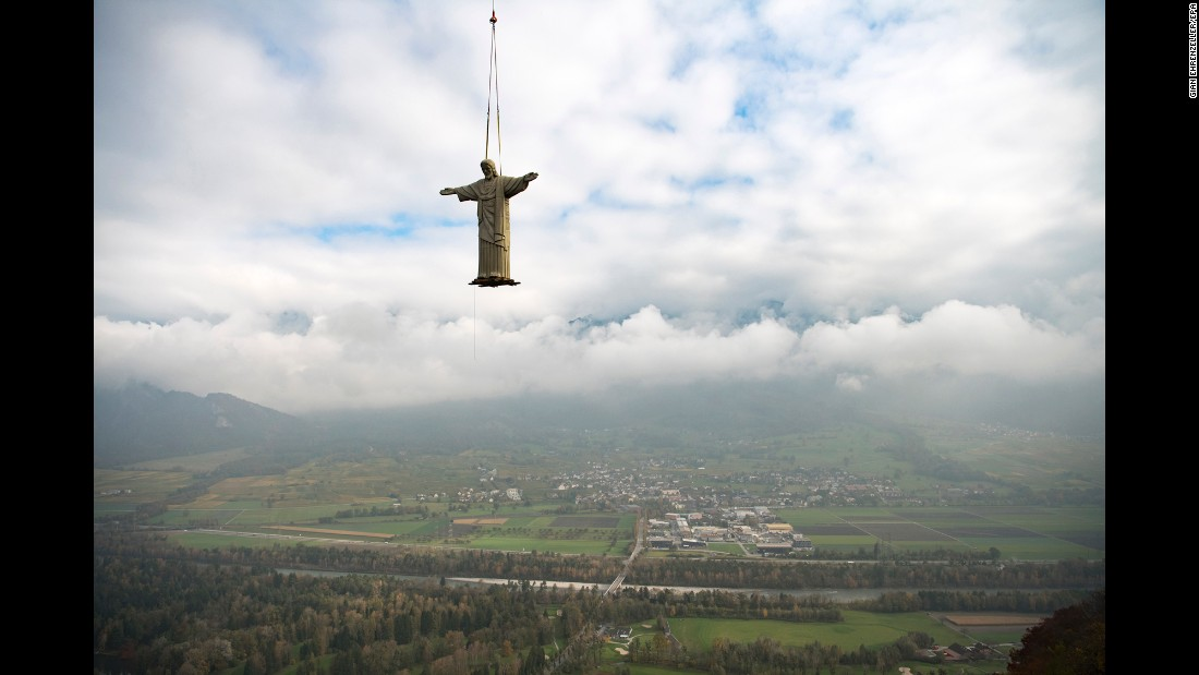 A replica of Rio de Janeiro's Christ the Redeemer statue is lifted by a helicopter in Pfafers, Switzerland, on Thursday, October 27.