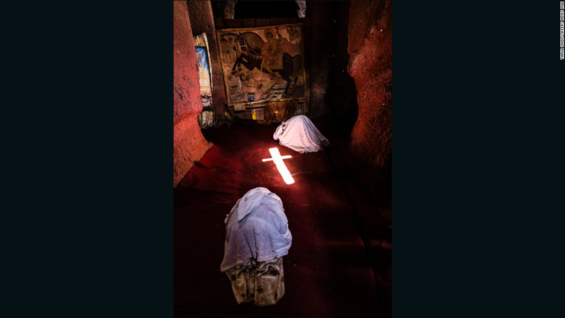 Pilgrims prostrate themselves in front of a tapestry of St George -- the patron saint of Ethiopia -- in one of Lalibela's ancient churches. Light shining in from the window projects a cross on to the floor, just one example of how these structures, hand-carved some 800 years ago, still work in harmony with their environment.