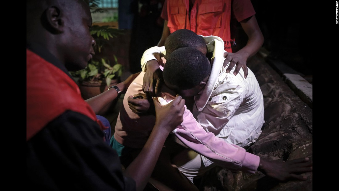 """People comfort each other at a mortuary after <a href=""""http://www.cnn.com/2016/10/25/africa/kenya-attack/"""" target=""""_blank"""">a terrorist attack</a> claimed the lives of 12 people at a hotel in Mandera, Kenya, on Tuesday, October 25. Officials said they believe the jihadist group Al-Shabaab was responsible."""