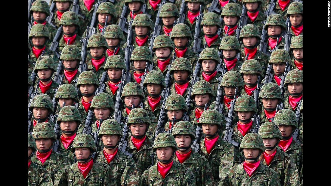 Japanese troops march during a military parade in Asaka, Japan, on Sunday, October 23.
