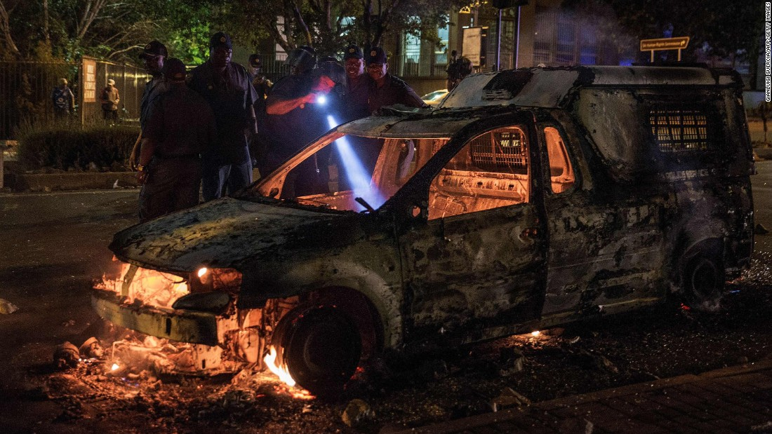 "South African police inspect a police van that was set on fire Tuesday, October 25, during skirmishes with protesters in Johannesburg. Students have been voicing their frustration over an increase in South Africa's university fees. <a href=""http://www.cnn.com/2016/10/20/world/gallery/week-in-photos-1021/index.html"" target=""_blank"">See last week in 32 photos</a>"