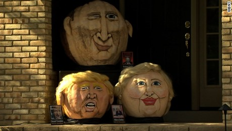"Behold Trumpkin the giant pumpkin! Jeanne Moos reports Trumpkin meets Clintkin in the political pumpkin patch.     Pumpkin Trumpkin    Pumpkins have gone political as the nation's most famous pumpkin portraitist displays this year's characters...Trumpkin, Clintkin, and Putkin. Jeanette Paras has been ""pumpkinizing"" celebs since 1988 and this year she's chosen 3 of the hottest names in news, the Donald, Hillary and Vladimir. All 3 are on display on her Dublin, Ohio porch. She's not really an artist but her creations have a cartoon quality that makes them funny. We have sound with Jeanette plus pix of her greatest hits from Kanye to Kim Jung Un. Might also briefly detour to Halloween masks of the candidates. Usually the best selling mask wins the actual election. Trump is outselling Hillary but retailers say he's being bought by both supporters and those who want to mock him, throwing off predictions. Plus 95% of rubber masks are bought by men. Chances are guys don't want to don a dress or pantsuit and dress up as Hillary."