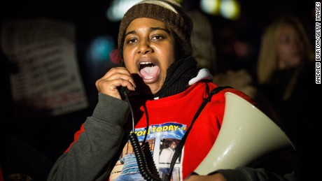Erica Garner, daughter of Eric Garner,  leads a march of people protesting the Staten Island, New York grand jury's decision not to indict a police officer involved in the chokehold death of Eric Garner in July, on December 11, 2014 in the Staten Island Neighborhood of New York City. Protests have continued throughout the country since the Grand Jury's decision was announced last week.  (Photo by Andrew Burton/Getty Images)