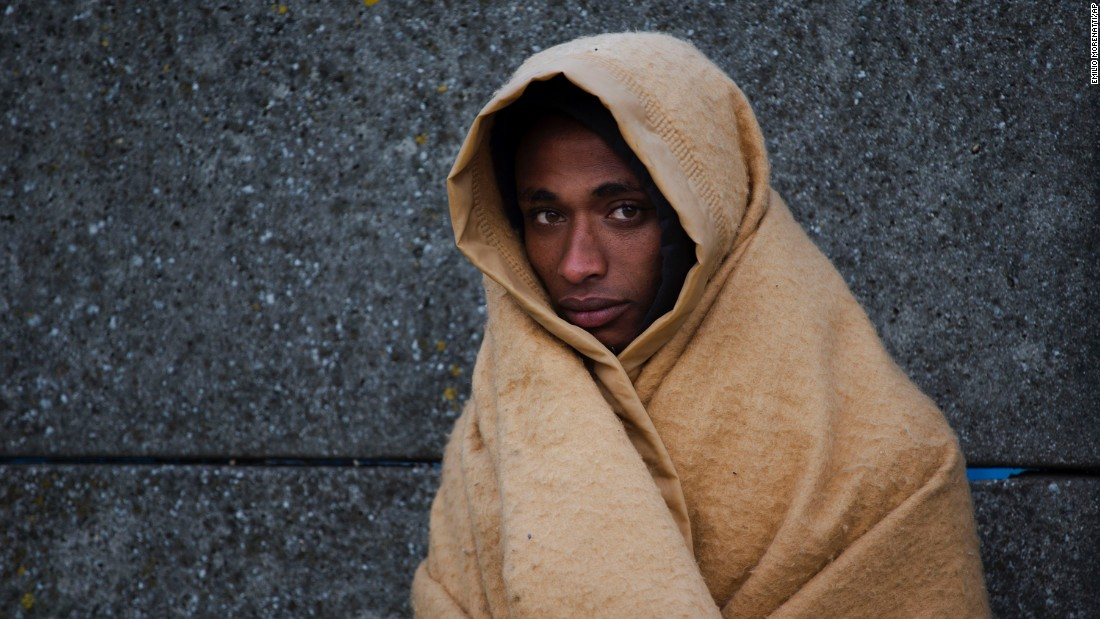 An Eritrean migrant waits to be relocated out of the camp on October 27. French authorities have given thousands of people who were living in the infamous migrant camp two options: seek asylum in France or return to your country of origin.