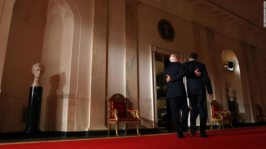 "Obama and Biden put their arms around each other after Obama's <a href=""http://www.cnn.com/2010/POLITICS/03/23/health.care.main/"" target=""_blank"">health care overhaul</a> was passed in March 2009. It was the biggest expansion of health care guarantees in more than four decades, and it represented a significant step toward the goal of universal coverage, which has been sought by every Democratic President since Harry Truman."