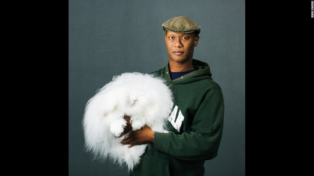Marcus Rhoden, of Chesaning, Michigan, holds his English Angora named Felicia.