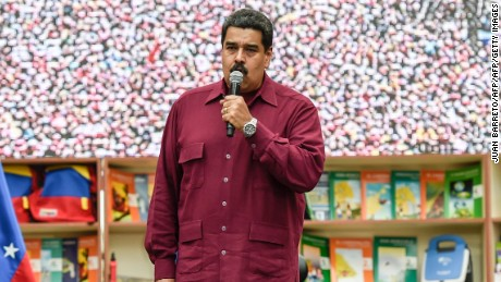 "Venezuelan president Nicolas Maduro(C)delivers a speech during a meeting in Caracas on October 28, 2016.  Maduro threatened on Friday to jail his political opponents if they follow through on their vow of launching a legislative trial to remove him from power. ""If they launch a supposed political trial, which is not in our constitution, the state prosecution service must bring legal action in the courts and put in jail anyone who violates the constitution, even if they are members of congress,"" Maduro said in a public speech. / AFP / JUAN BARRETO        (Photo credit should read JUAN BARRETO/AFP/Getty Images)"