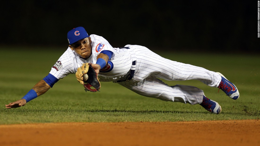 Addison Russell of the Cubs makes a diving catch for an out during the third inning in Game 3.