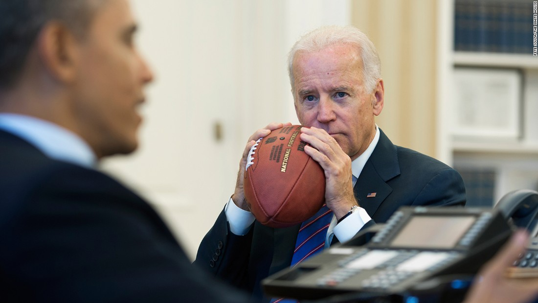 Biden holds a football during an October 2013 conference call discussing the country's debt ceiling and a federal government shutdown.