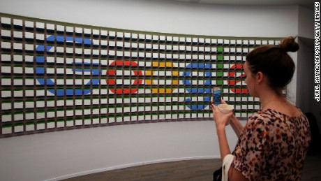 "A woman takes pictures of a sign after the opening of Google's pop-up store in New York on October 20, 2016. Google opened its first retail store, which is a pop-up store, intended to showcase the range of new ""Made by Google"" products. / AFP / Jewel SAMAD        (Photo credit should read JEWEL SAMAD/AFP/Getty Images)"