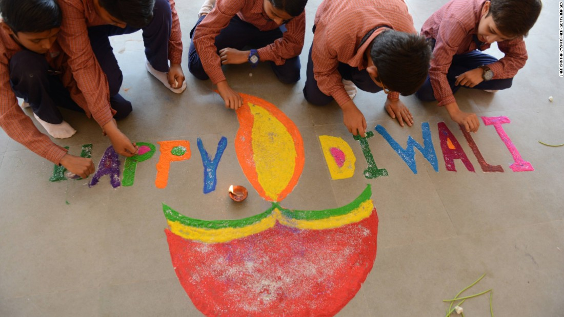 Muslim students prepare a colorful Rangoli with an oil lamp illustration at a high school in Ahmedabad, India, on October 27.