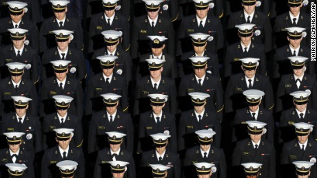 Members of the U.S. Naval Academy stand in formation on the field before an NCAA college football game between Navy and Memphis in Annapolis, Md., Saturday, Oct. 22, 2016. (AP Photo/Patrick Semansky)