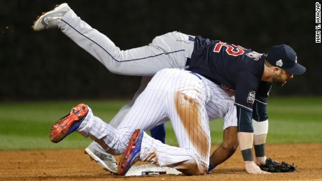 Cleveland Indians second baseman Jason Kipnis collides with Chicago Cubs' Jason Heyward as Kipnis turns a double play on a ball hit by Javier Baez during the second inning of Game 4 of the Major League Baseball World Series Saturday, Oct. 29, 2016, in Chicago. (AP Photo/Nam Y. Huh)