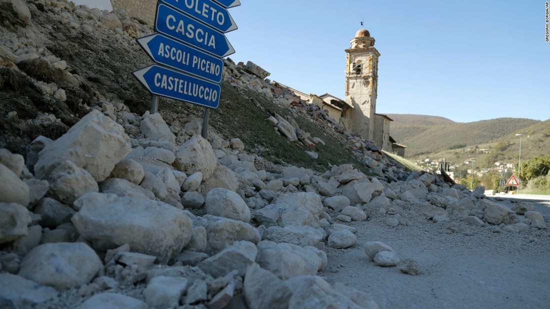 The tower of the Church of the Madonna of the Angels remains standing amid rubble near Norcia on October 30.