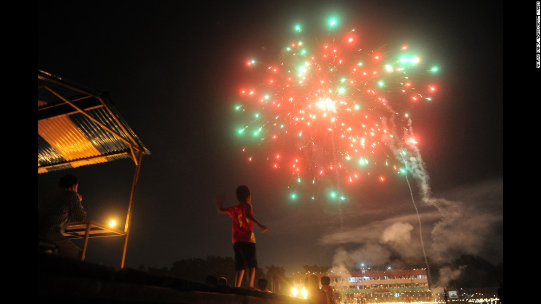 A child watches fireworks at the Madan Mohan Malviya Stadium  in Allahabad, India, on the eve of the Hindu festival of Diwali on October 29.