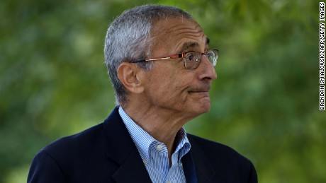 John Podesta, Clinton Campaign Chairman, walks to Democratic presidential nominee Hillary Clinton's Washington DC home October 5, 2016 in Washington, District of Columbia.
