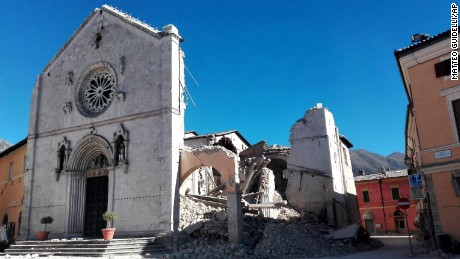 The Basilica of San Benedetto's facade remains standing in Norcia, but its core crumbled Sunday.
