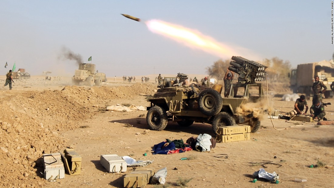 Shiite fighters launch missiles against ISIS in the village of Salmani, south of Mosul, on October 30.