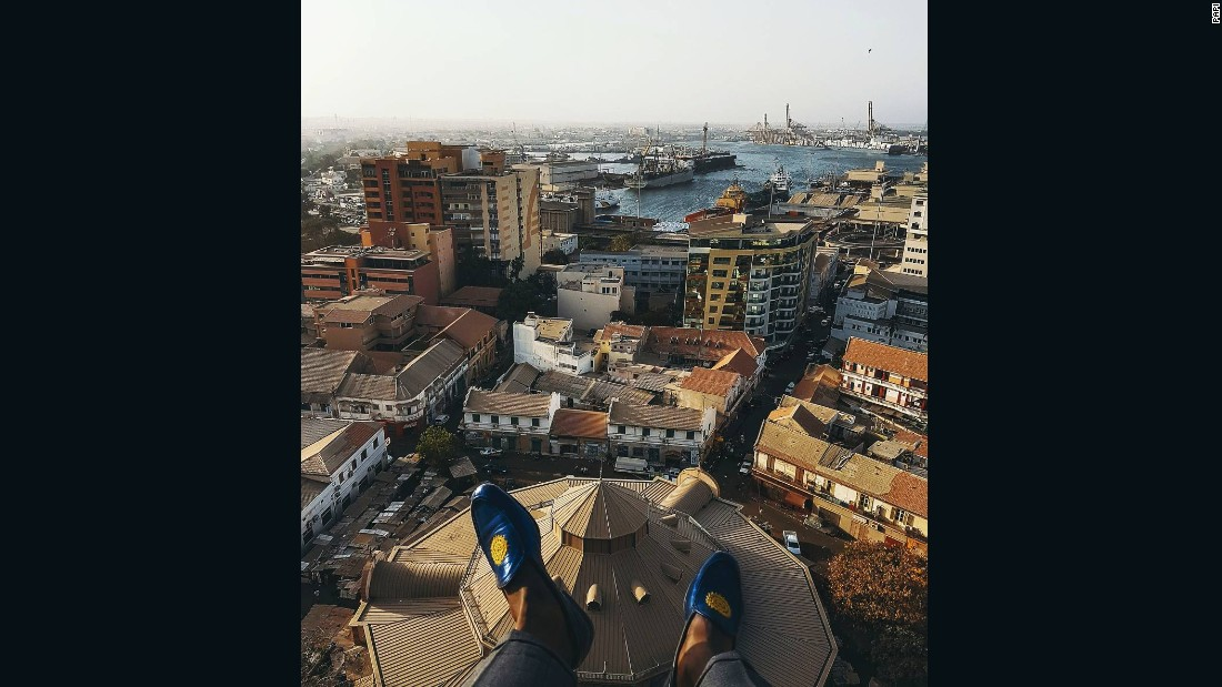 "Dakar Lives has partnered with travel company Tastemakers Africa to curate unique tourism experiences in Senegal. Pictured, the view above Dakar's historic Kermel market. Photo by <a href=""https://www.instagram.com/l.artrepreneur/?hl=en"" target=""_blank"">@l.artrepreneur</a>."