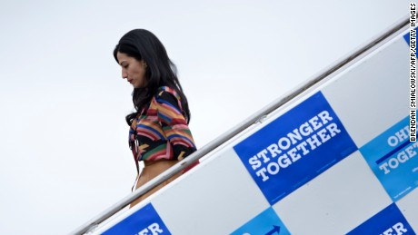 Huma Abedin, top Clinton aide, arrives with Democratic presidential nominee Hillary Clinton at Toledo Express Airport  October 3, 2016 in Swanton, Ohio.