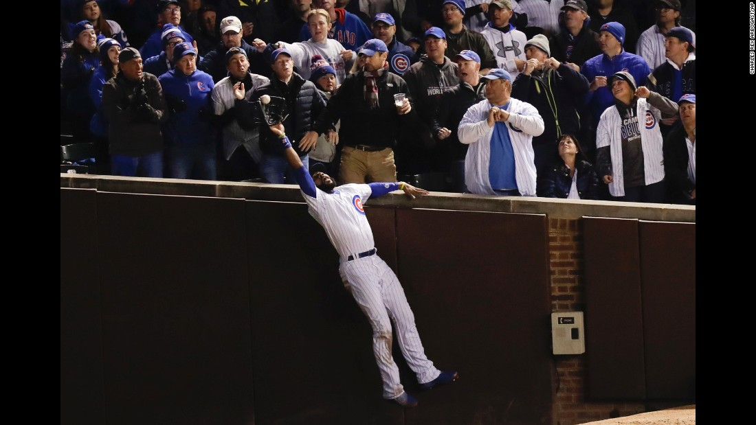 Cubs right fielder Jason Heyward catches a fly ball hit by  Indians' Trevor Bauer during the third inning of Game 5.