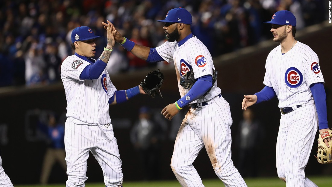 Javier Baez, left, Jason Heyward, center, and Kris Bryant of the Cubs celebrate after Game 5.