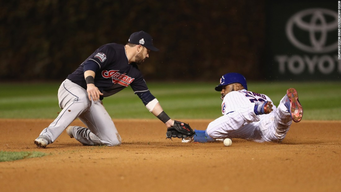 Jason Heyward of the Chicago Cubs steals second base past Jason Kipnis of the Cleveland Indians in the eighth inning in Game 5.