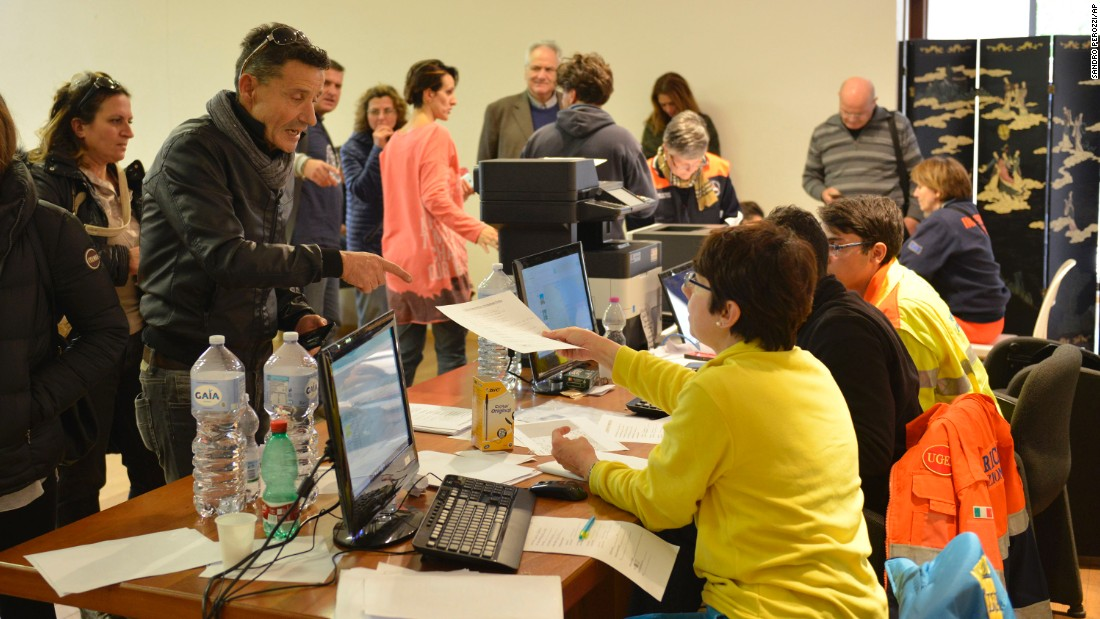 Italian authorities register people for temporary accommodations in the Adriatic coastal town of Porto Sant'Elpidio on October 31, after more than 15,000 were displaced by the latest earthquakes to hit central Italy.