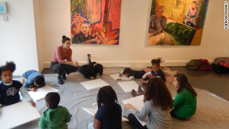 Children of market traders enjoy an art class.