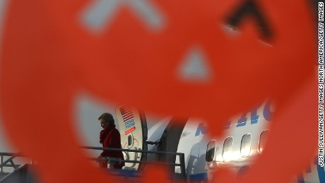 ERLANGER, KY - OCTOBER 31:  A Halloween pumpkin decoration frames Democratic presidential nominee former Secretary of State Hillary Clinton as she arrives at Cincinnati Northern Kentucky International Airport on October 31, 2016 in Erlanger, Kentucky. With just over a week to go until election day, Hillary Clinton is campaigning in the battleground state of Ohio.  (Photo by Justin Sullivan/Getty Images)
