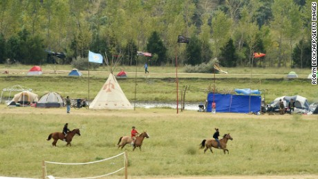 Youths ride horses at an oil pipeline protest encampment near Cannon Ball, North Dakota.