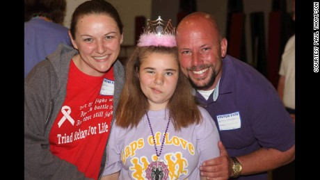 Bethany with her parents, Wendy Feucht and Paul Thompson, at the Relay for Life. Nerve damage from cancer treatment affected Bethany's smile.