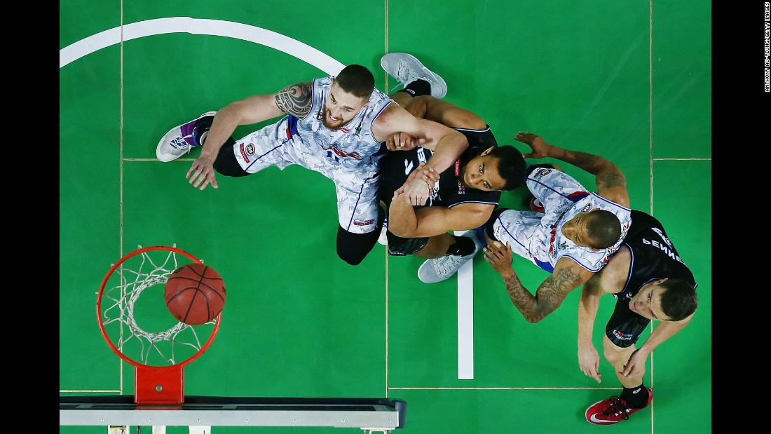 Players from the New Zealand Breakers and the Adelaide 36ers try to box each other out during an NBL game in Auckland, New Zealand, on Friday, October 29.