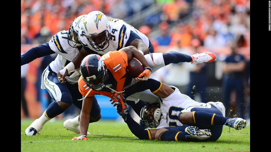 Denver wide receiver Jordan Norwood is dragged down by San Diego safety Dwight Lowery during an NFL game in Denver on Sunday, October 30.