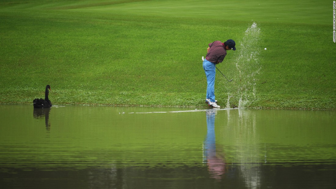 Xiong Zong hits his ball out of the water during a pro-am event in Shanghai, China, on Wednesday, October 26.