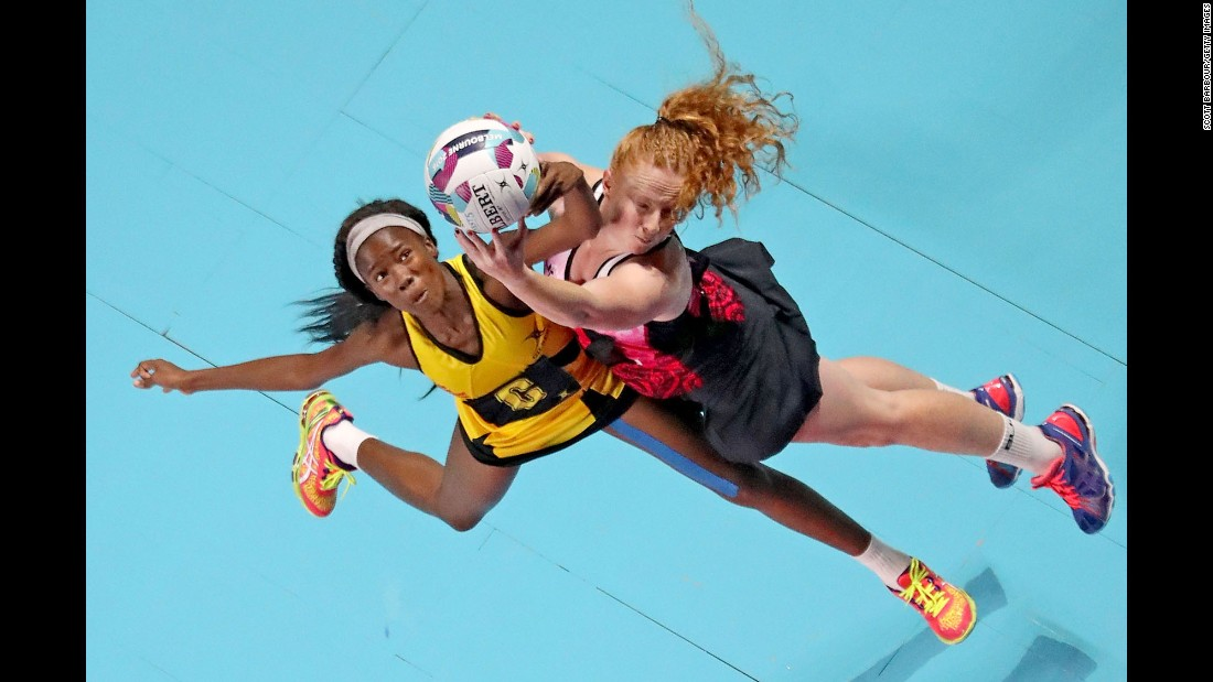 Jamaica's Nicole Dixon, left, and New Zealand's Sam Sinclair compete for the ball during a netball match in Melbourne on Sunday, October 30.