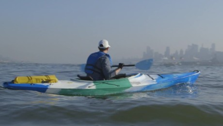 man commutes to work by kayak schwitzky_00022327